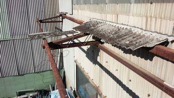 高崎市綿貫町工場破損したスレート屋根